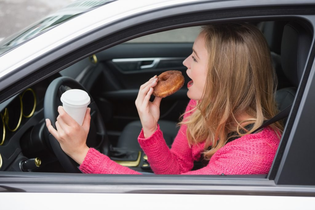 YES, eating a donut at the wheel counts as distracted driving. You didn't know that?